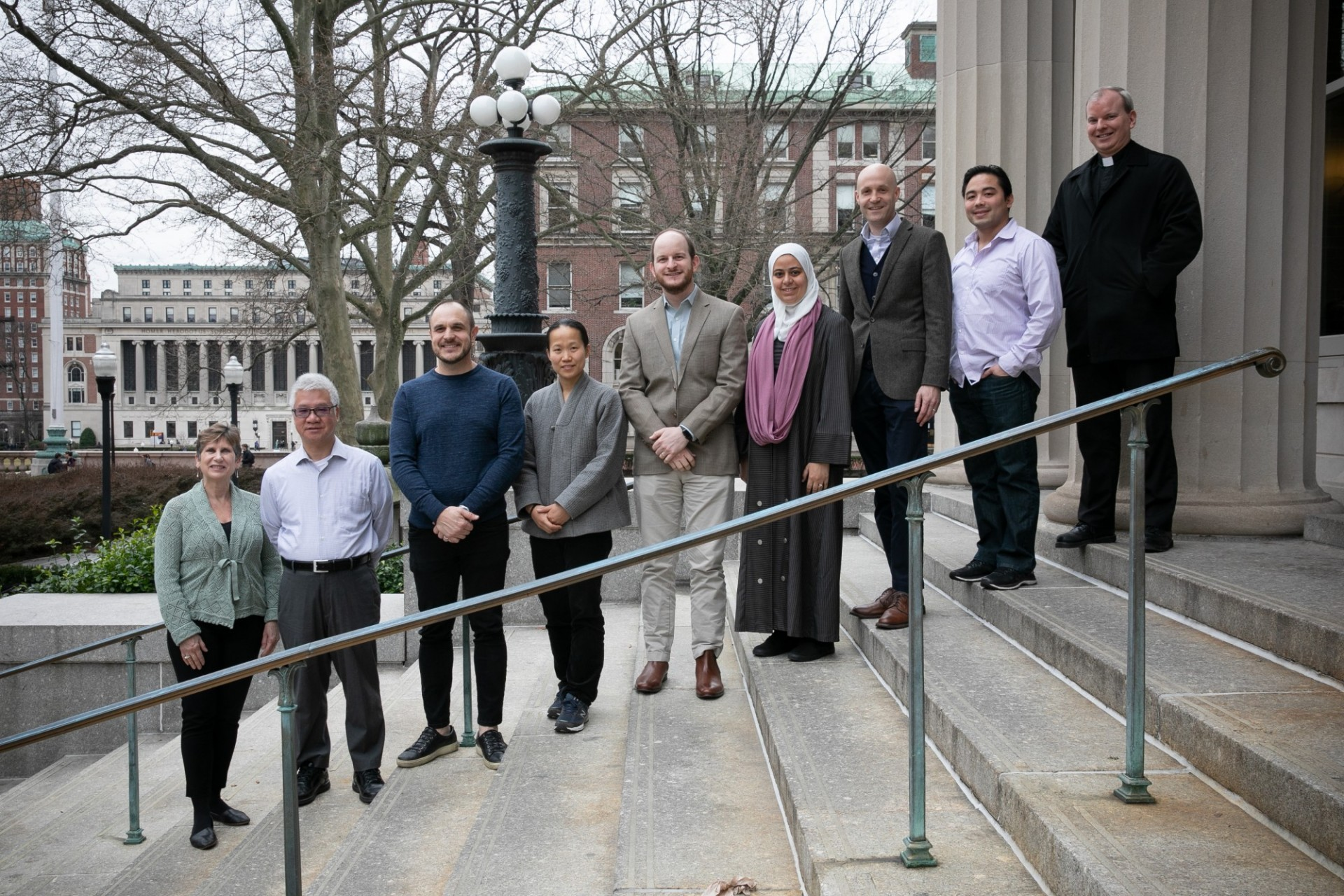 Our diverse religious life advisers on the stairs that lead up to Earl Hall.